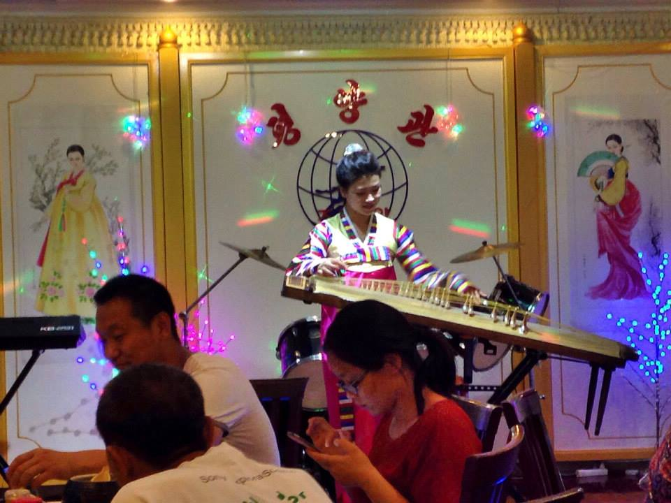 A server performs at a North Korean restaurant