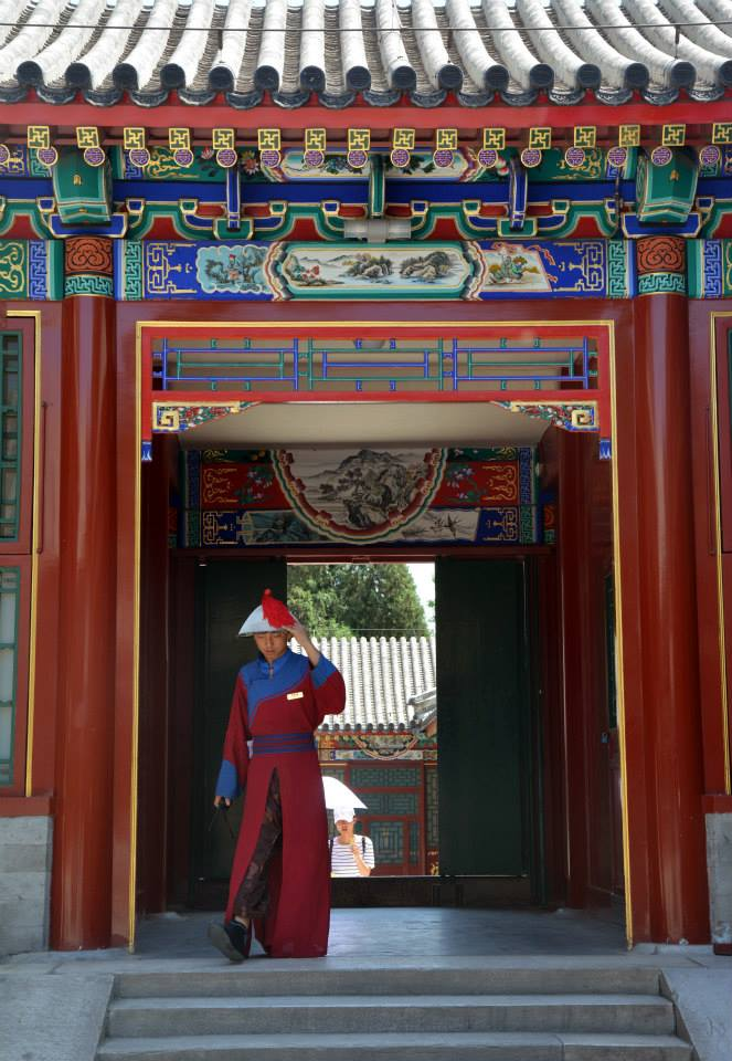 A man stands in traditional dress at the Summer Palace