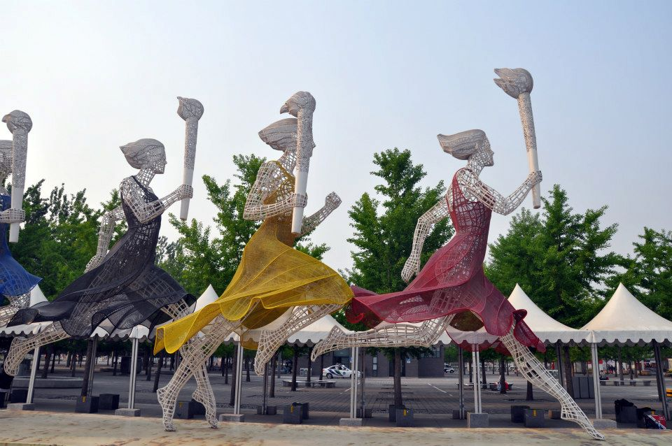 A statue of athletes in the Olympic Park