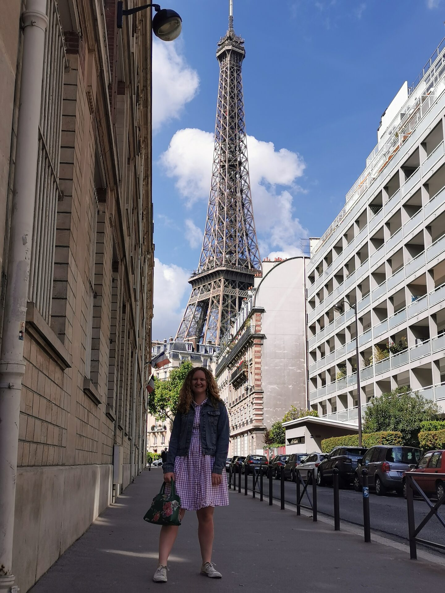 Sophie on a side street in front of the Eiffel Tower