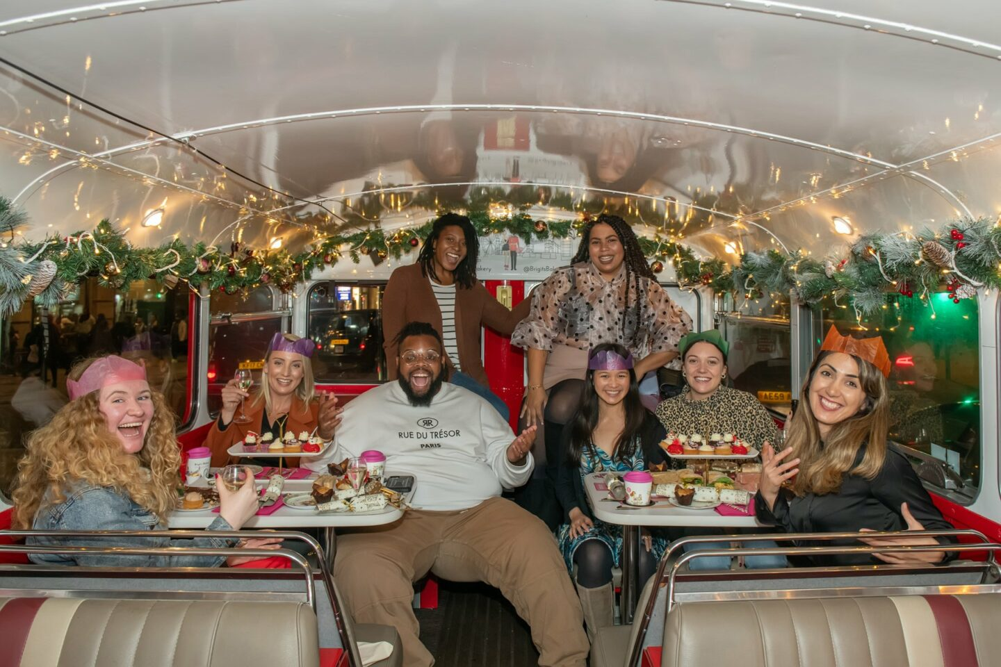 Sophie and a number of bloggers sat together inside the afternoon tea bus
